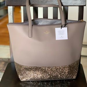 Grey Kate Spade purse. New with tags.